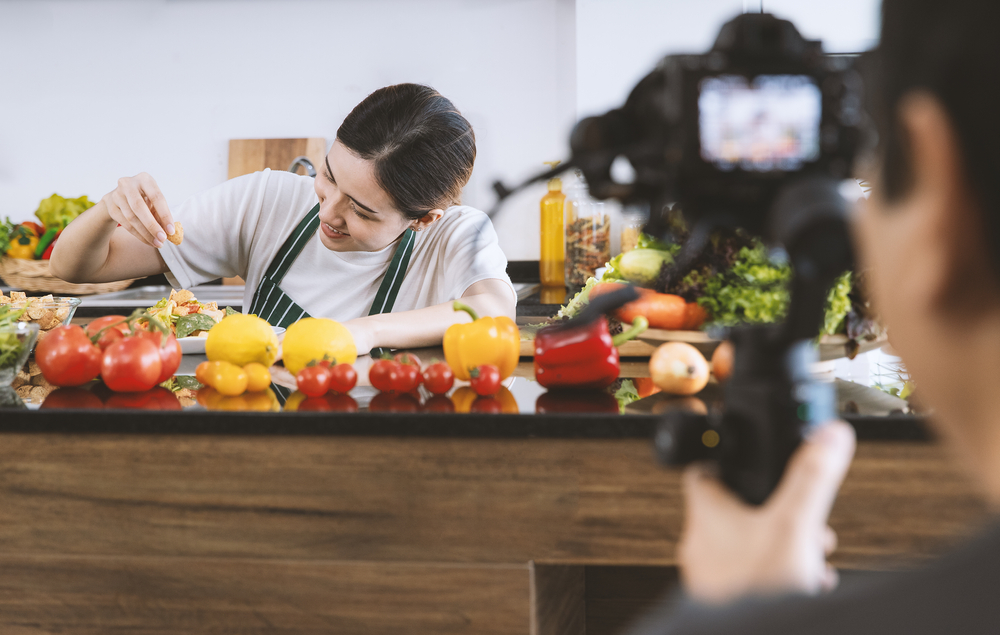 young woman recording her cooking